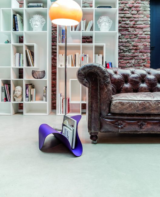 Chesterfield sofa, Abaco bookcase and Fly magazine rack by Tonin Casa