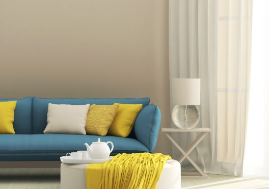 light interior with blue sofa and yellow cushions